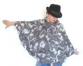Nuno felted poncho  wrap capelet seamless Grey leaf stole