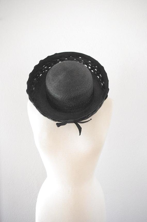 1960's black straw hat by Schiaparelli