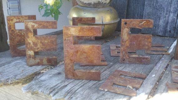 "1 Lot of 10 Rusty Metal ""E"" Shaped Findings"
