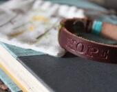Hope debossed leather bracelet