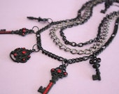 Black three tiered multi-chain crown and key charms necklace