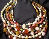 VINTAGE 7 STRAND LARGE GERMAN BEADED NECKLACE.  EARTH TONES AND PEARLS AND VINTAGE BEADS. TRENDY AND LARGE