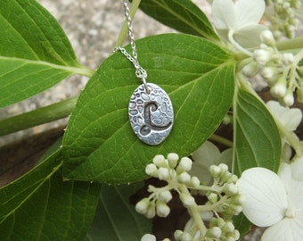 oval initial charm