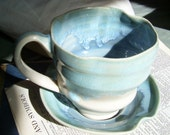 Delicate Blue Porcelain Cup and Saucer- Alice in Wonderland with the sea inside.