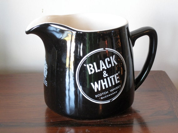 vintage ceramic water pitcher / black and white / wade pottery
