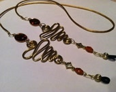 Vintage Amber Faceted Czech Glass with Gold Aluminum Wire Work Eyeglass Holder