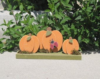 TRIPLE PUMPKINS on a base with a ladybug for home decor, porch, Autumn and Fall decor