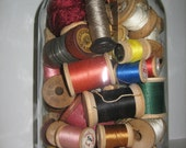 On Hold For Ivette---------------- - Giant Vintage Glass Jar Filled with 80 Vintage Wooden Spools of Thread