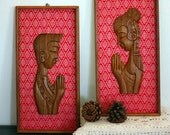 Vintage Man and Woman Art Wood Carvings with Red and White Fabric Background