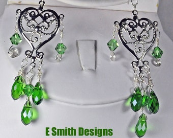Beautiful green crystal and silver plated elements make up these chandelier earrings