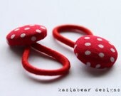 pony tail holder.. red with white polka dots..