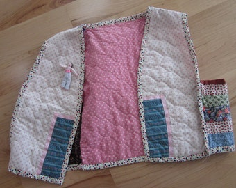 Handmade and reversible, Calico, quilted vest, shades of pink and burgundy with floral and ribbon trim
