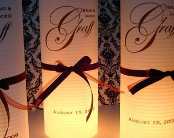 10 DIY table number luminaries includes ribbon, votives and candles