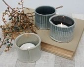 Three hand built porcelain tealight/votive holders in stormy blue and celadon