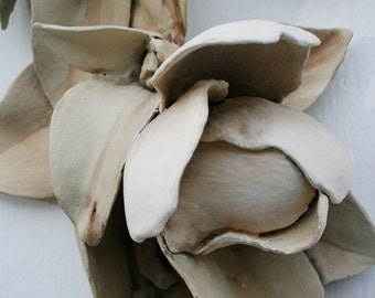 Sculpted ceramic magnolia branch. Natural, neutral, blossom, foliage, rustic, woodland, poetic.