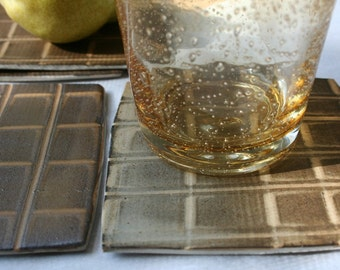 Set of four stoneware coasters in tan and brown. Rustic, geometric, eartthy, feathered, hand painted, hand made.