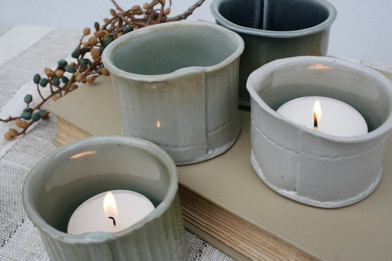 Group of four porcelain tealight or votive candleholders