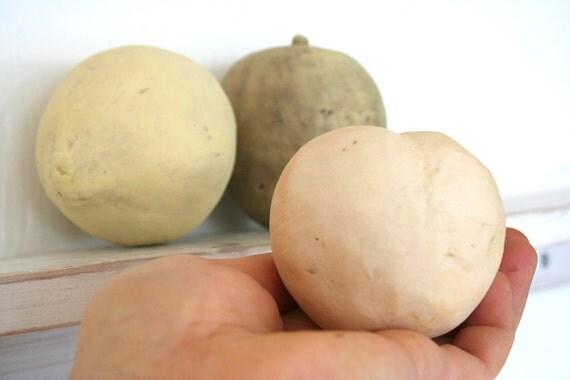 Group of three earthenware fruit