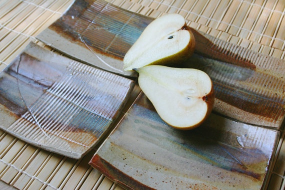 Set of four rustic stoneware dishes