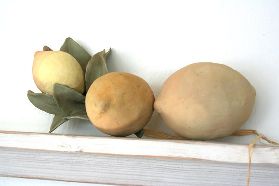 Three hand-built earthenware lemons