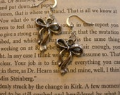 CLEARANCE ITEM: Small, Silver Bow Earrings