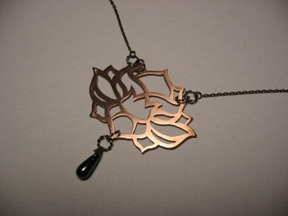 Lotus pendant in copper and hematite