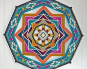 Heart to Heart, a custom order Ojo de Dios. All wool yarns, 18 inches, 8-sided