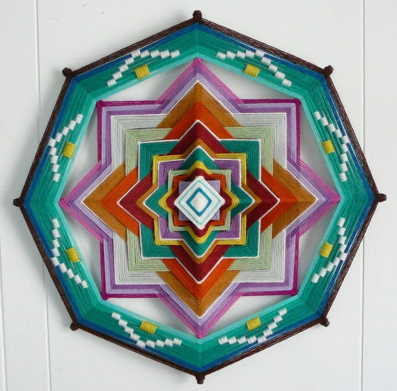Mother Earth, Father Sky, a 16 inch, 8-sided Ojo de Dios yarn mandala, by custom order