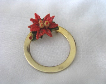 Gold tone vintage circle pin brooch with red enamel poinsettia