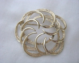 Gold tone Tailored Swirl Vintage Brooch Pin by Sarah Coventry