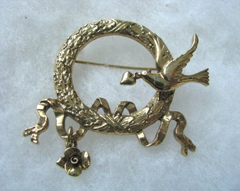 Gold tone embossed circle brooch pin with bird & flower dangle.Vintage pin. Vintage brooch