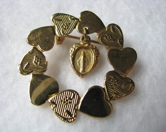Gold tone religious vintage wreath pin brooch with hearts & Mary medal