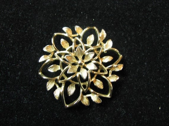 Peta- lure gold tone flower pin brooch  by Sarah Coventry