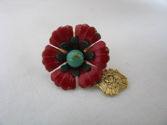 Tiny red enamel flower lapel pin brooch with green center and gold dangle