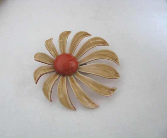 Light tan pinwheel enamel flower pin brooch with orange center