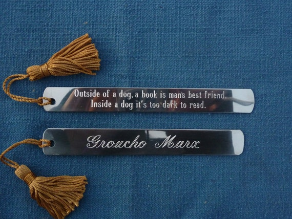 """Pewter Bookmark: """"Outside of a dog, a book is man's best friend. Inside a dog it's too dark to read."""""""