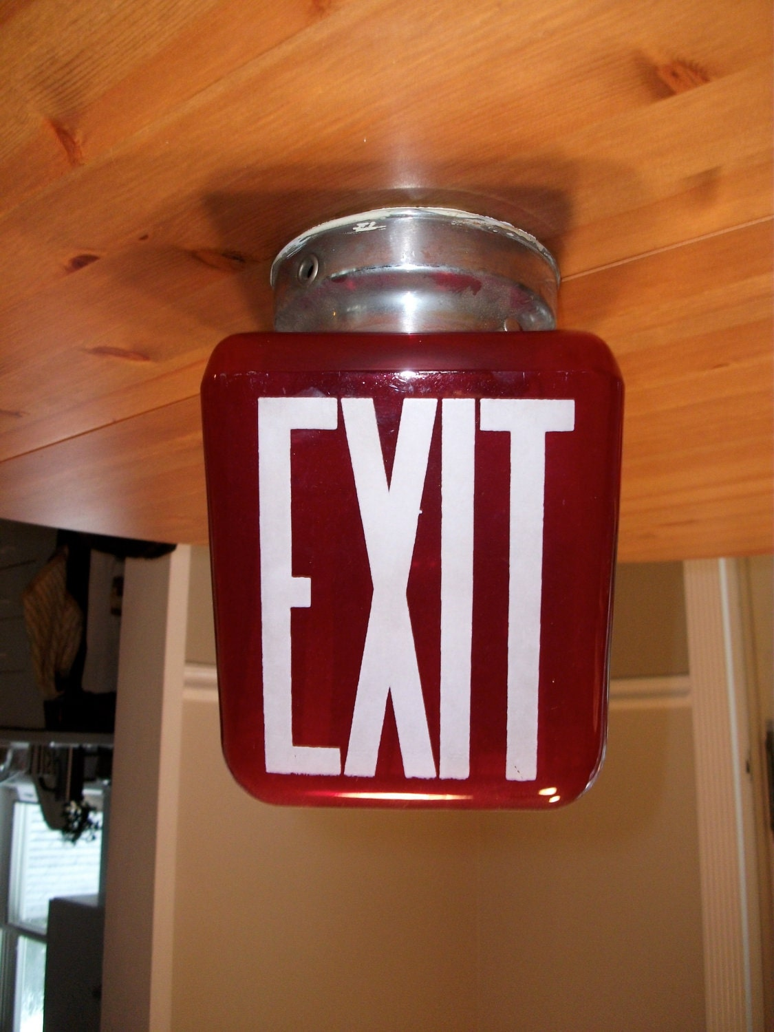 vintage glass exit sign with light fixture and lightbulb art
