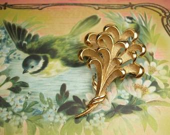 Vintage Monet Filigree brushed gold brooch signed
