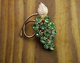 Vintage peridot cluster vine brooch