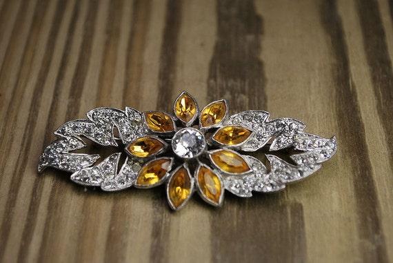 Vintage silver and amber rhinestone brooch