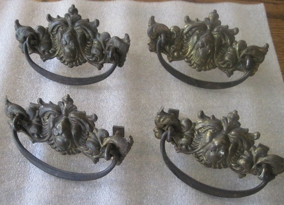 Set of 4 vintage/antique Lion Head drawer pulls brass