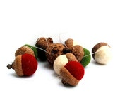 Christmas Wool Acorn Ornaments in red, white, and green with invisible filament string