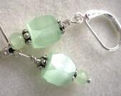 Luminous sea green satin glass earrings
