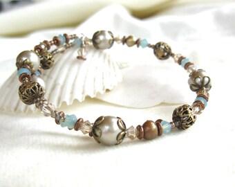 Lovely champagne, bronze and azure beaded bracelet