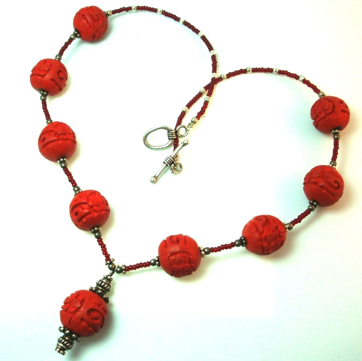 carved cinnabar bead necklace with sterling