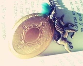 A locket necklace accompanied whith a turquoise czech glass melon and a double sided unicorn charm