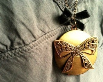 Authentic aged vintage locket with a precious filigree brass bow tie necklace, your secret  inside
