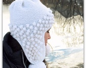 Knit earflap hat with bobbles and pompoms made of  white glittery wool blend. Skiing snowboarding. Handmade in Colorado USA