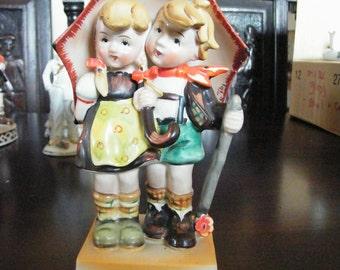 1940 Porcelain Figurine of Children Under Umbrella