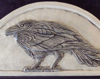 Handmade relief carved ceramic raven hanging